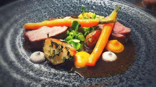 Roasted rump of lamb, mint roasted baby potatoes, baby carrots, broad beans & peas, carrot purée, anchovy emulsion, lamb jus